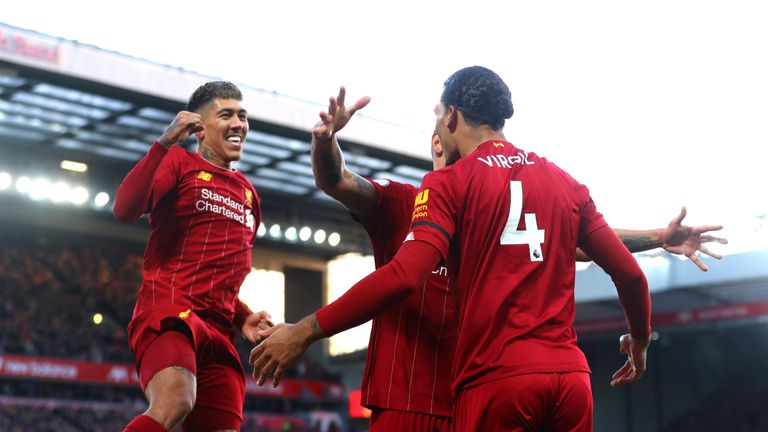 Virgil van Dijk celebrates with his Liverpool team-mates