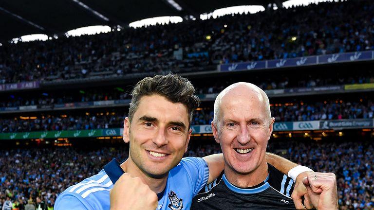 Paul Clarke celebrates the five-in-a-row triumph with Bernard Brogan