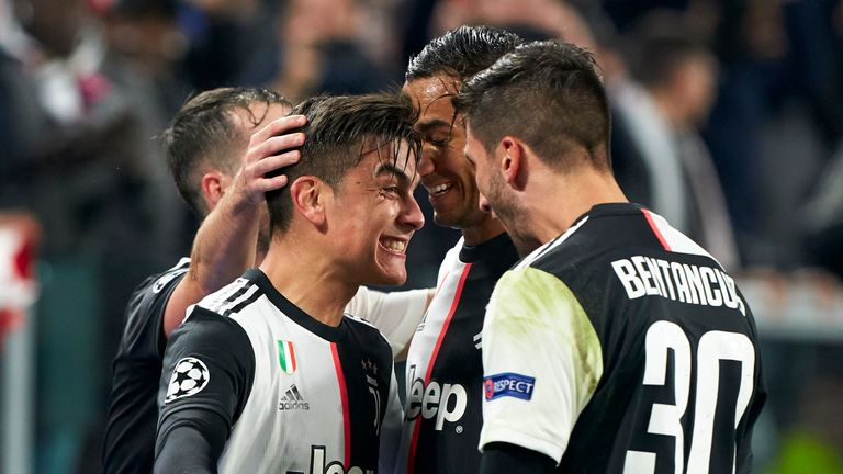 Paulo Dybala celebrates with Juventus team-mates after his fine free-kick