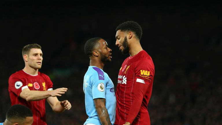 Raheem Sterling and Joe Gomez exchange words during Liverpool's 3-1 defeat of Manchester City at Anfield