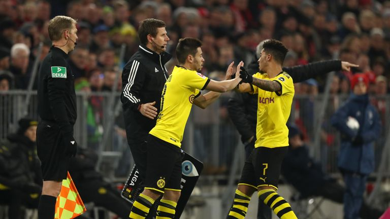 Sancho (r) is replaced by Raphael Guerreiro against Bayern Munich in the Allianz Arena