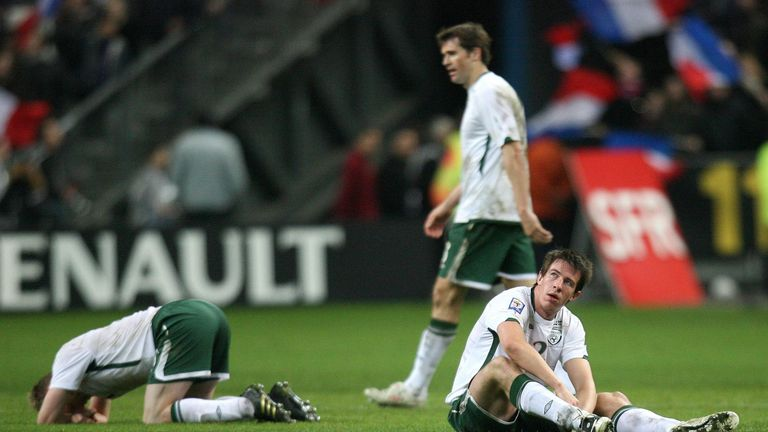 A distraught St Ledger (centre) after the full-time whistle