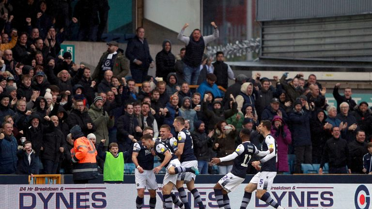 Millwall's Shaun Hutchinson celebrates scoring his side's first goal of the game with his team-mates