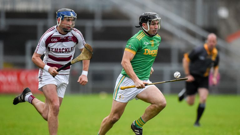 Kevin McKeague of Dunloy is chased by Meehaul McGrath of Slaughtneil