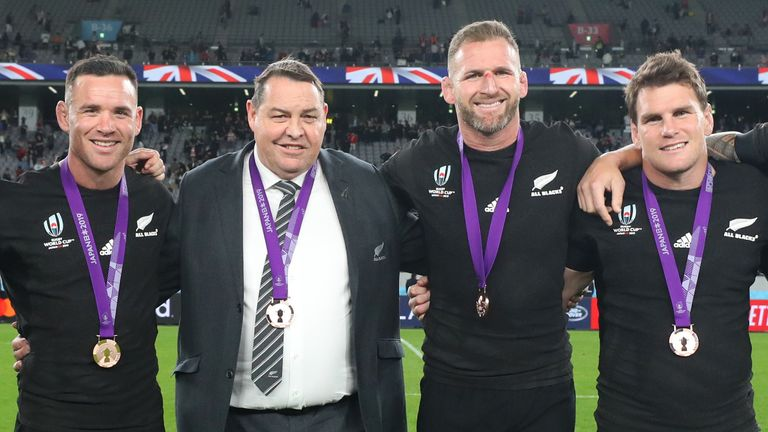 The All Blacks celebrate securing bronze against Wales