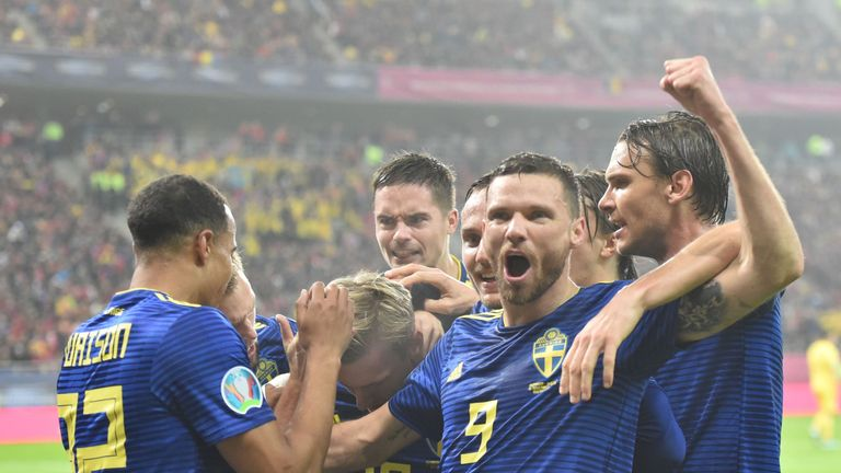 Marcus Berg is mobbed after putting Sweden into the lead in Bucharest