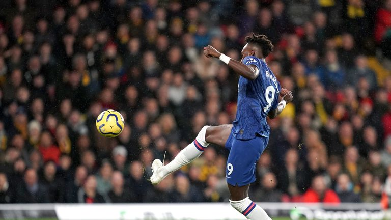 Chelsea's Tammy Abraham scores his side's first goal of the game at Vicarage Road