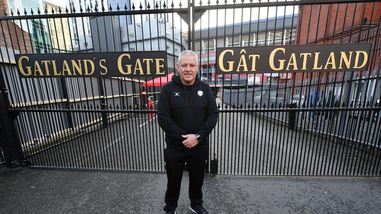 Warren Gatland in front of the gates named after him