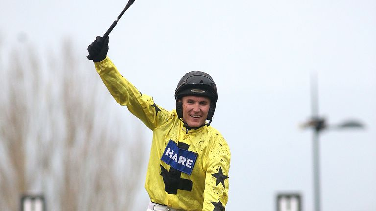 Tom Bellamy celebrates after winning the Greatwood Hurdle