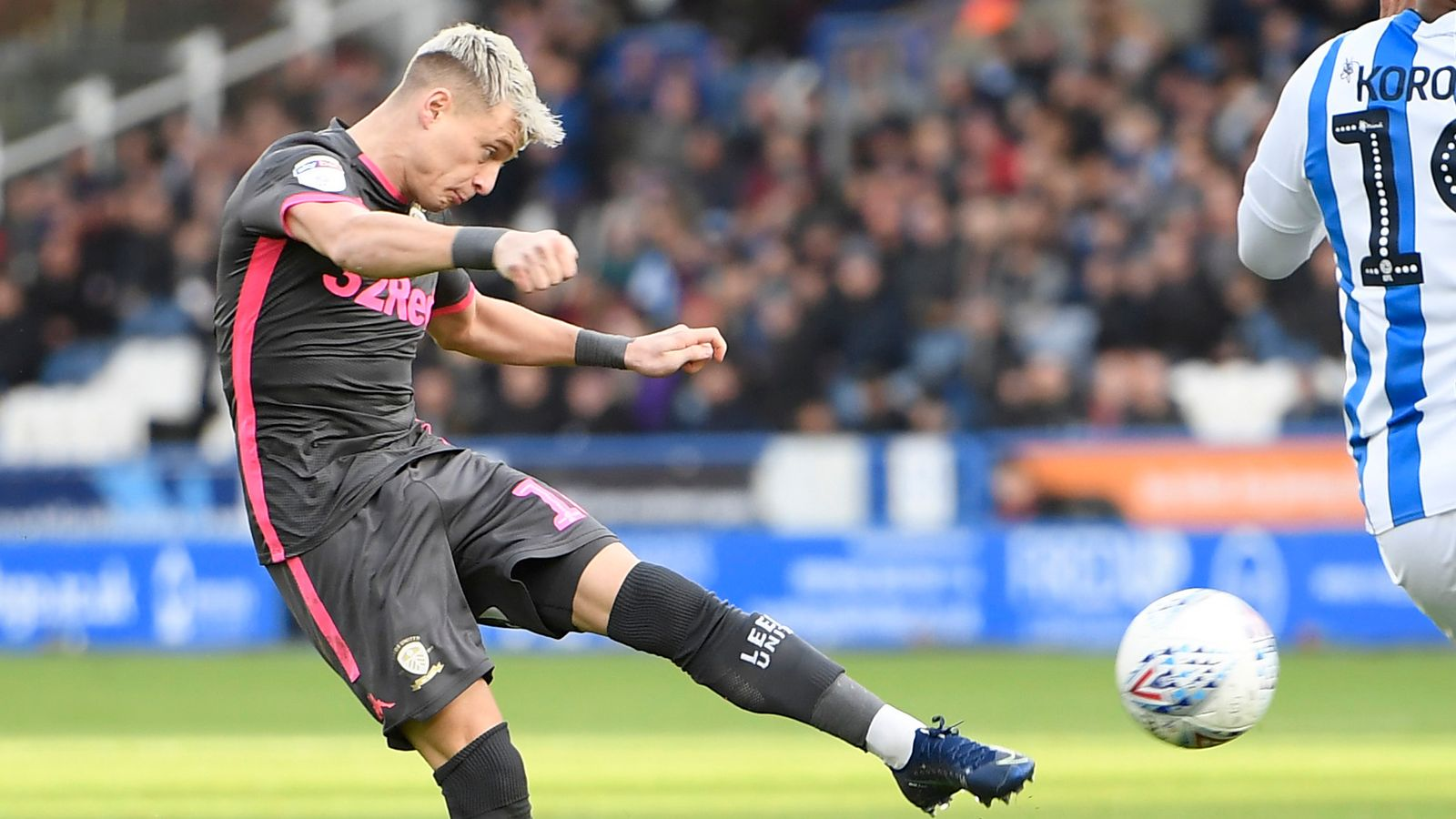 Huddersfield 0-2 Leeds: Marcelo Bielsa's side go top of the league after sixth straight win