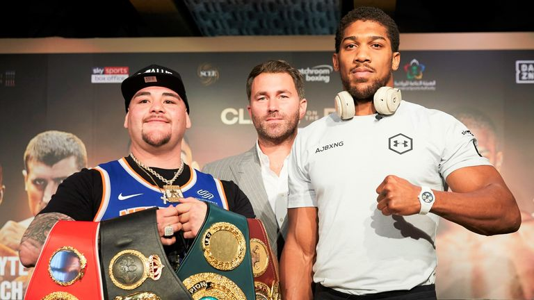 Ruiz Jr posed with the world titles which Joshua previously held