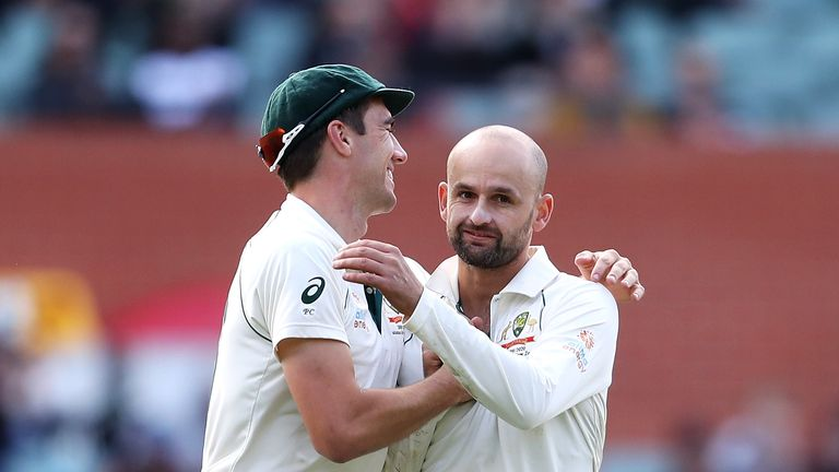 Nathan Lyon (R) celebrates with Pat Cummins after taking the wicket of Pakistan's Shaheen Afridi