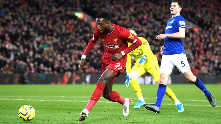 Divock Origi scores early for Liverpool in the Merseyside derby back in December