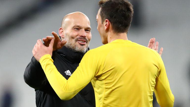 Ljungberg celebrates with Mesut Ozil after victory against West Ham