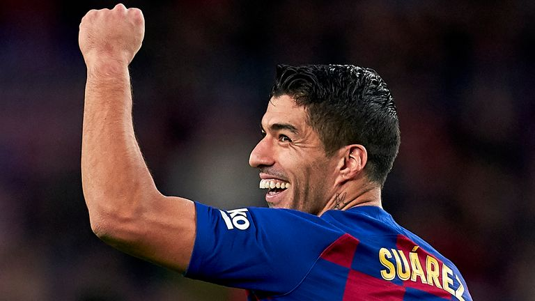 Luis Suarez helped fire Barcelona to a 4-1 win on Saturday