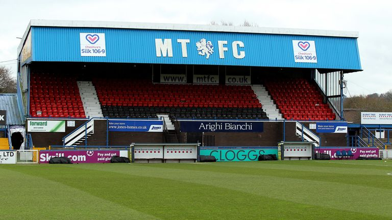 Macclesfield Town's owners have been given time to settle the club's debts