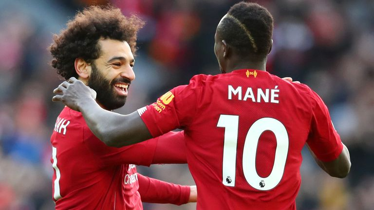 Salah celebrates a goal with Sadio Mane