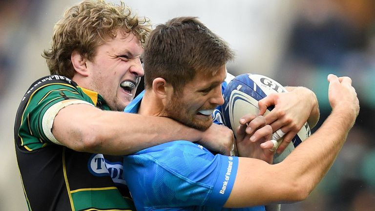 Ross Byrne is tackled by Northampton flanker Jamie Gibson