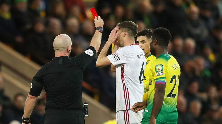 Chris Basham was initially shown a straight red card by referee Simon Hooper on Sunday - before VAR intervened