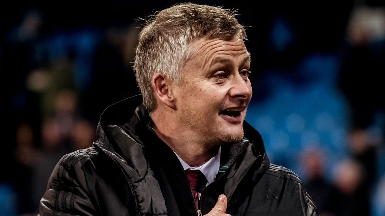 Ole Gunnar Solskjaer celebrates Manchester United's win in the derby