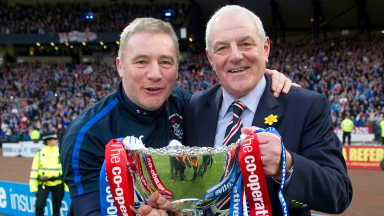 Smith and assistant Ally McCoist celebrate Rangers' League Cup final win in 2011