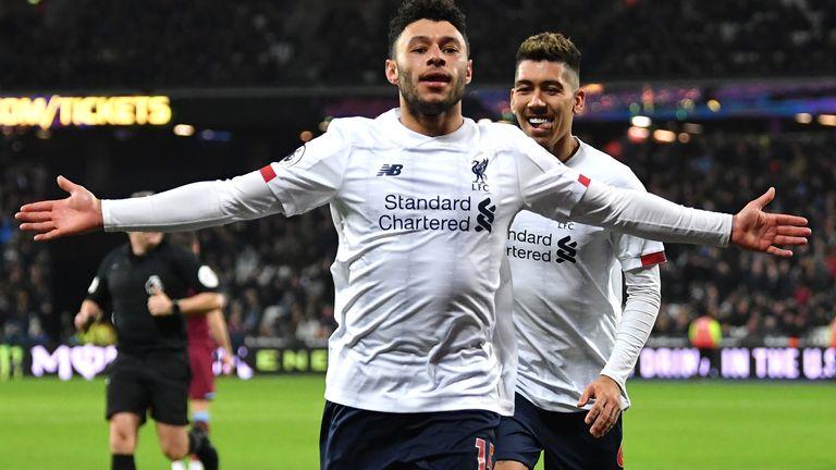 Alex Oxlade-Chamberlain celebrates after scoring Liverpool's second goal