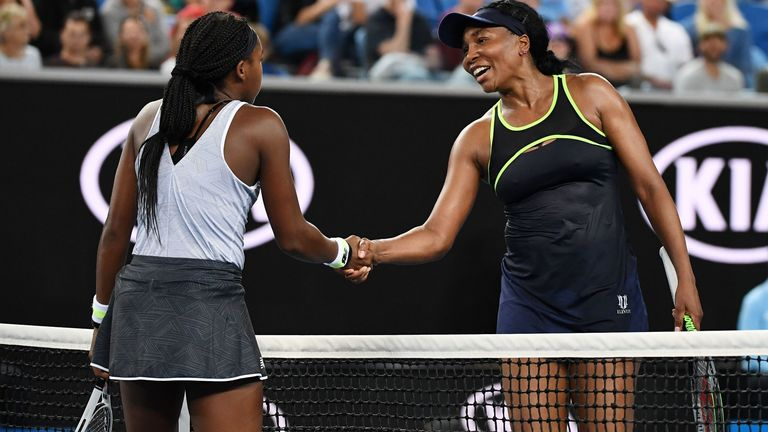 Gauff (L) shakes hands with Venus Williams at the net