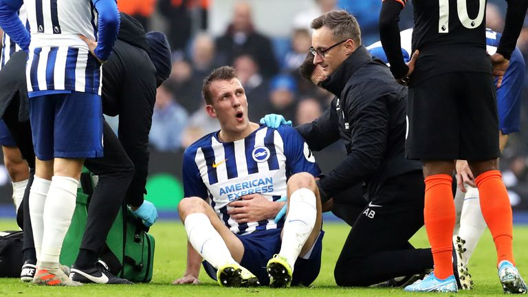 Dan Burn receives treatment before being substituted with an injury