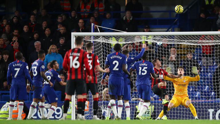 Bournemouth's Dan Gosling hooks the ball over the head of Kepa
