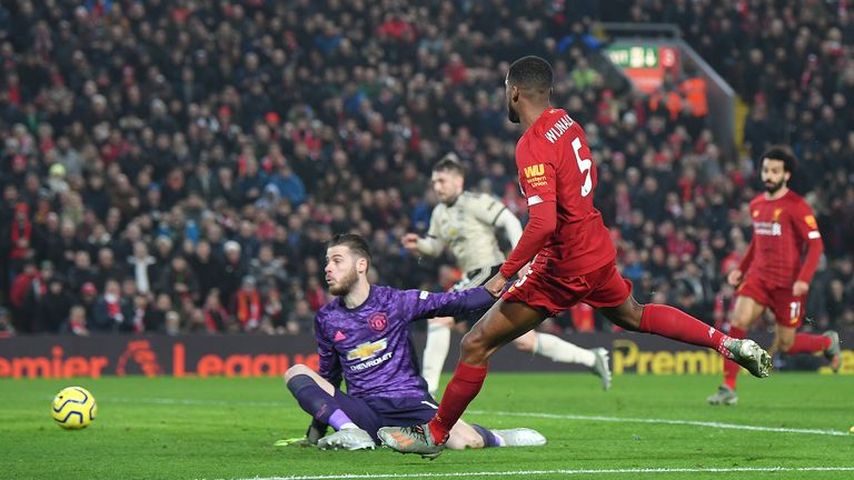 Wijnaldum slots the ball beyond David de Gea only to see the goal ruled out