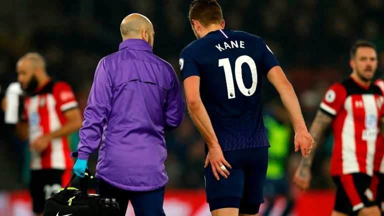 Harry Kane clutches his hamstring after picking up an injury
