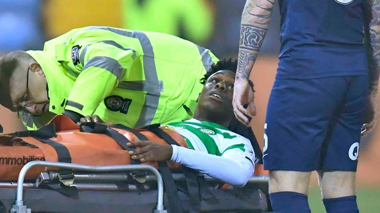 Frimpong exchanges words with Kilmarnock's Alan Power as he is stretchered off at Rugby Park