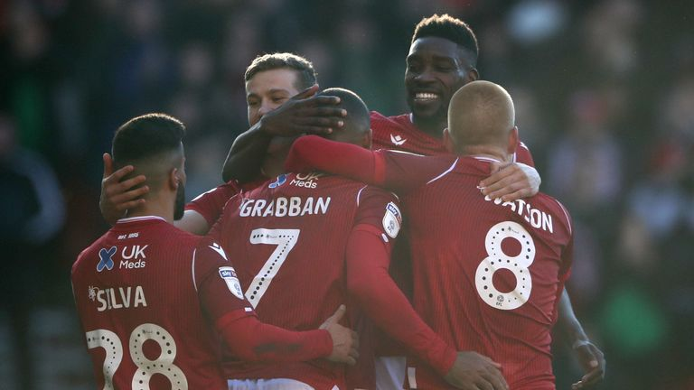 Lewis Grabban celebrates scoring Forest's third goal of the game against Luton