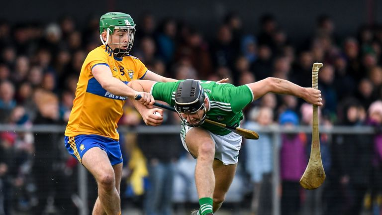 Conor Boylan of Limerick in action against  Colin Guilfoyle of Clare