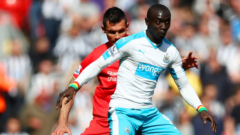 Former Newcastle striker Cisse shielding the ball from Liverpool's Dejan Lovren during a Premier League match in 2016