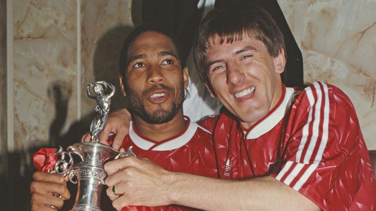 John Barnes and Peter Beardsley celebrate after winning the title in 1990