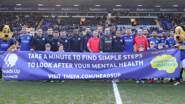 Players display a banner to raise mental health awareness prior to Birmingham City vs Blackburn Rovers