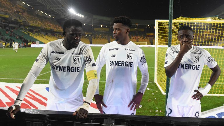 Nantes' players talk with their supporters at the end of the game with Bordeaux