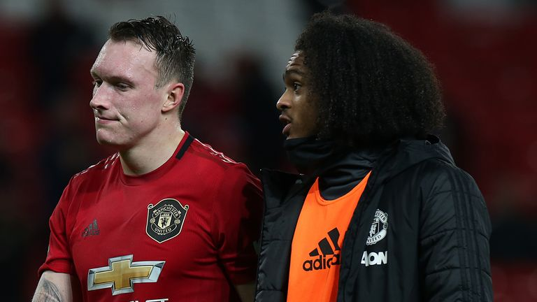 Phil Jones and Tahith Chong trudge off the Old Trafford pitch after the defeat