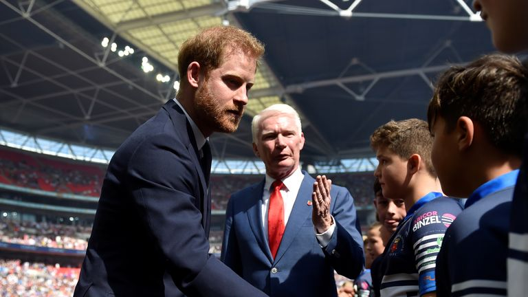 Prince Harry met the teams before the Challenge Cup final between St Helens and Warrington Wolves and later presented the trophy to Warrington