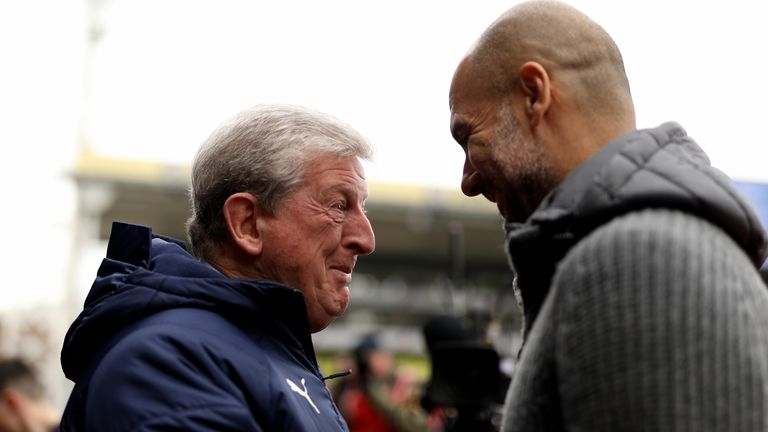 Hodgson (left) and Manchester City's Pep Guardiola before kick-off during last season's match at Selhurst Park