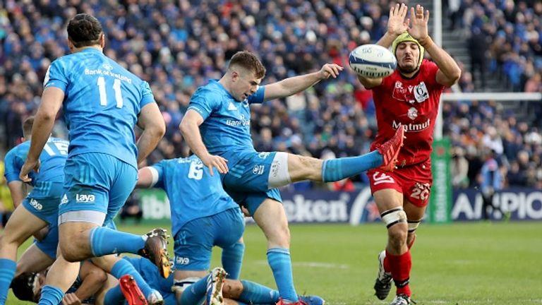 Leinster scrum-half Luke McGrath kicks the ball away during their win against Lyon