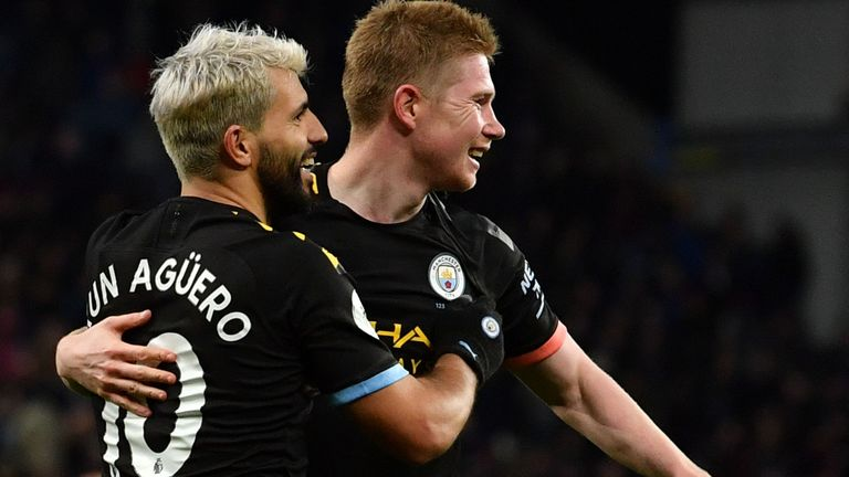 Sergio Aguero celebrates his record-breaking goal with Kevin De Bruyne