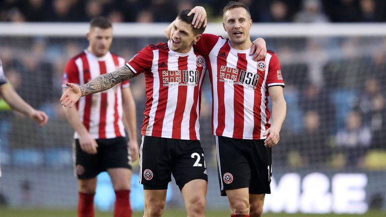 Mo Besic celebrates with Phil Jagielka after safe passage for Sheffield United