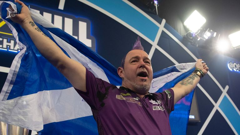An emotional Peter Wright after securing the ultimate prize in darts