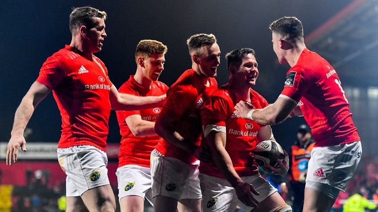 Arno Botha celebrates a try with his Munster team-mates