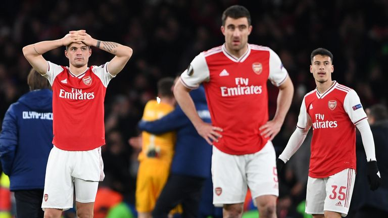 Arsenal players react after losing to Olympiakos