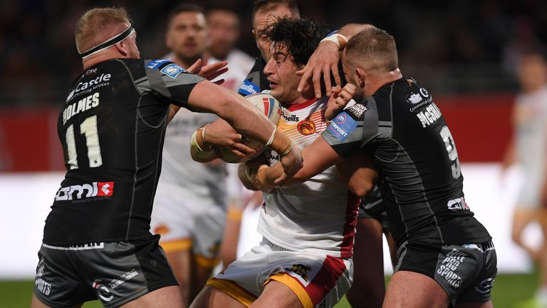 Catalans' Benjamin Garcia is wrapped up by Castleford defenders Oliver Holmes and Paul McShane