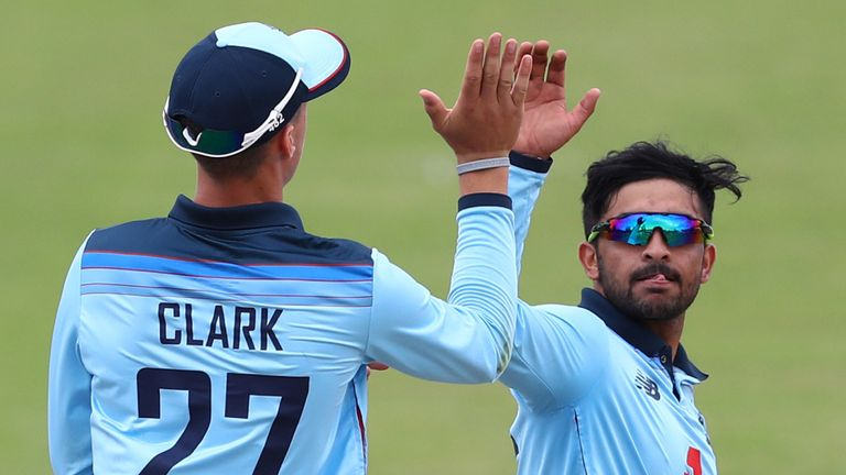 Hamidullah Qadri (right) celebrates a wicket with England U19 team-mate Tom Clark