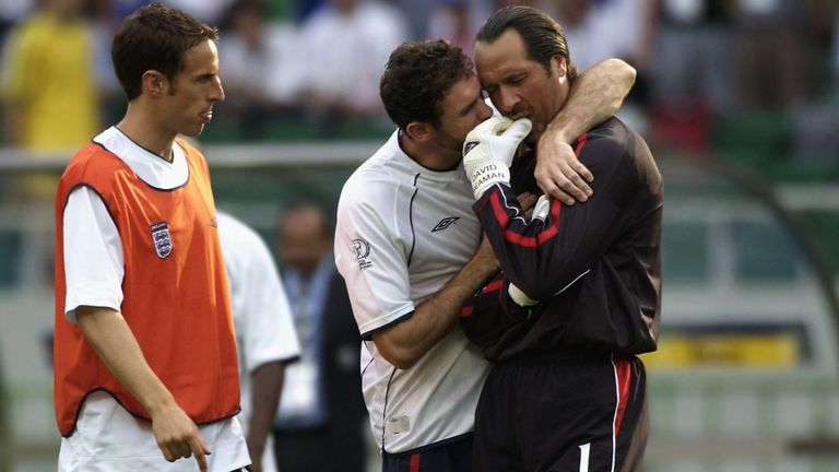 David Seaman is consoled after his mistake in the World Cup quarter-final against Brazil in 2002